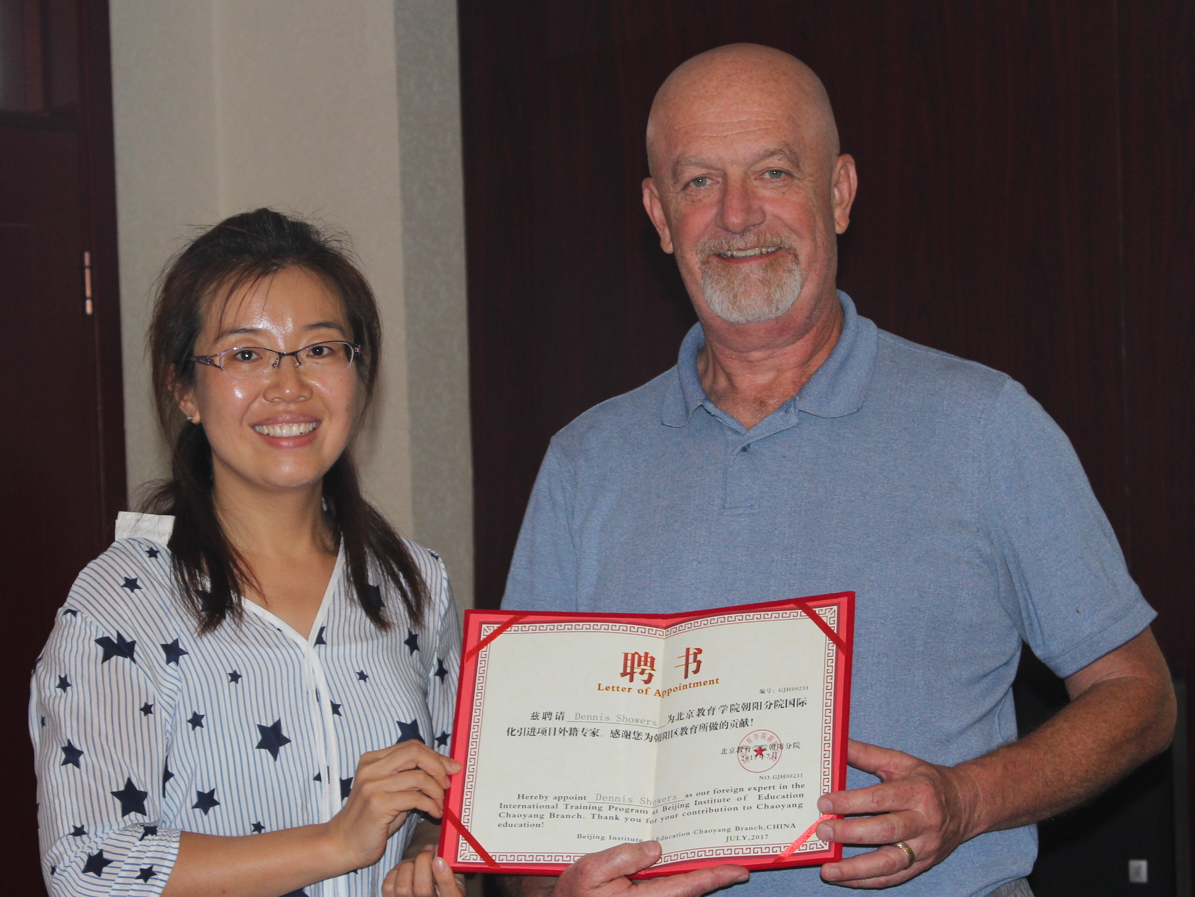 Dr. Showers receiving a certificate acknowledging him as a Foreign Expert in Interdisciplinary Teaching by The Changyang District of Beijing Schools