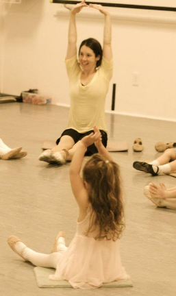 Jody DeLoria leading stretches in a dance class.