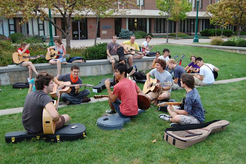 Students playing guitars