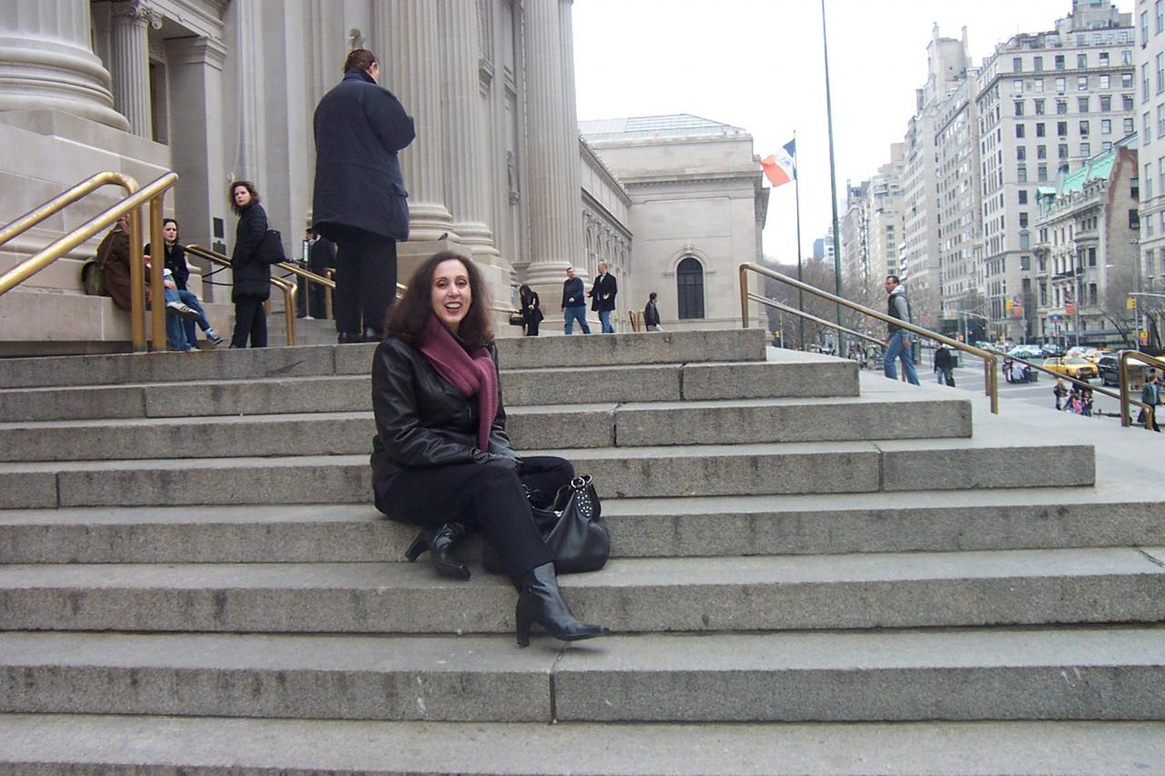 A student sitting on the steps of the Metropolitan Museum of Art, in NYC.