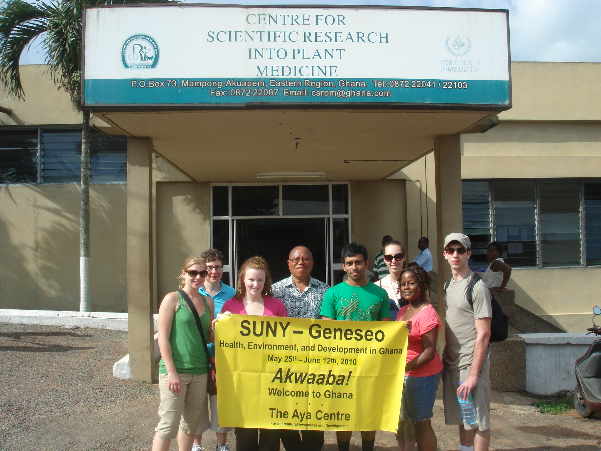group photo in front of center for scientific research into plant medicine