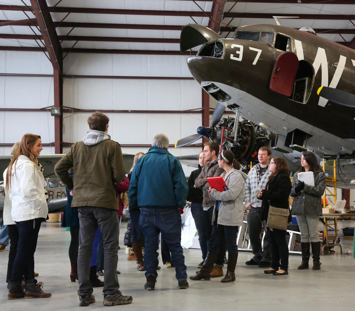 Group of people talking at the Plane Museum