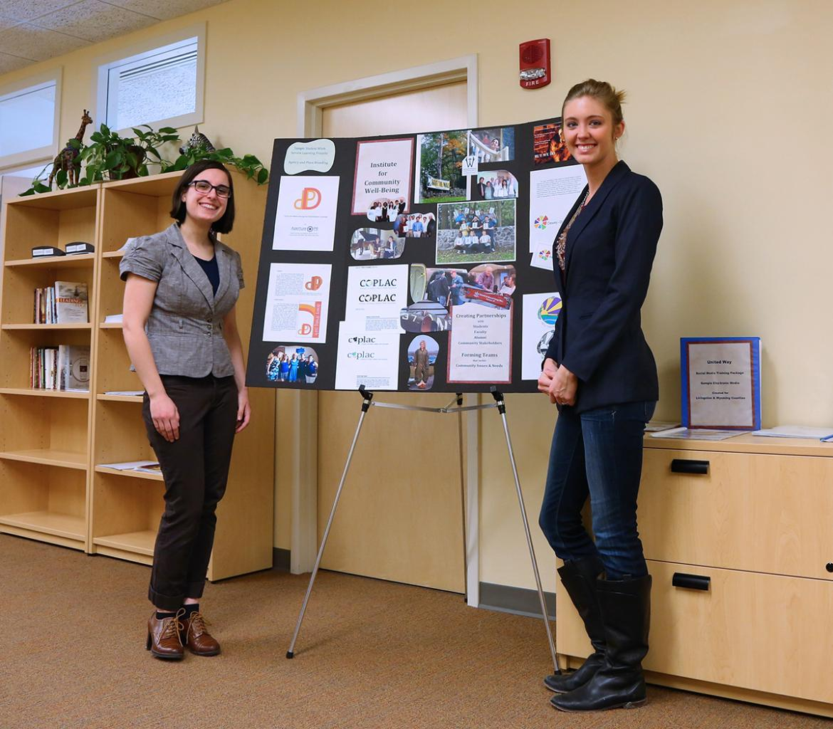 Two students presenting a poster.