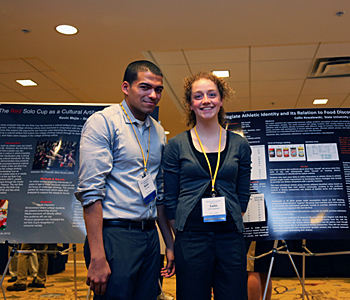 Two students presenting a poster