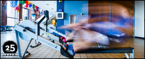 Blurred photo of someone rowing on an erg in the Union.