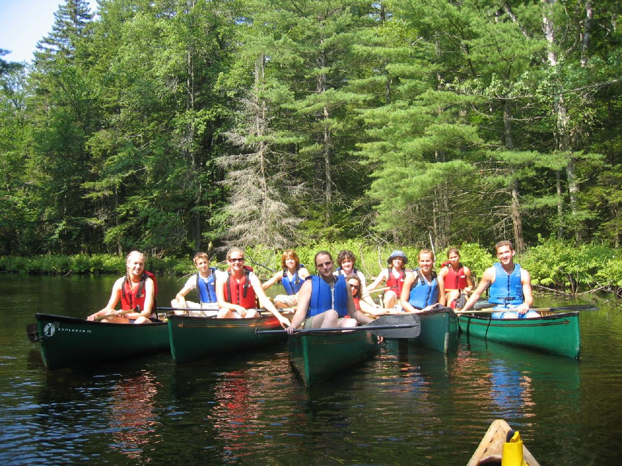 Students posing for photograph in kayaks