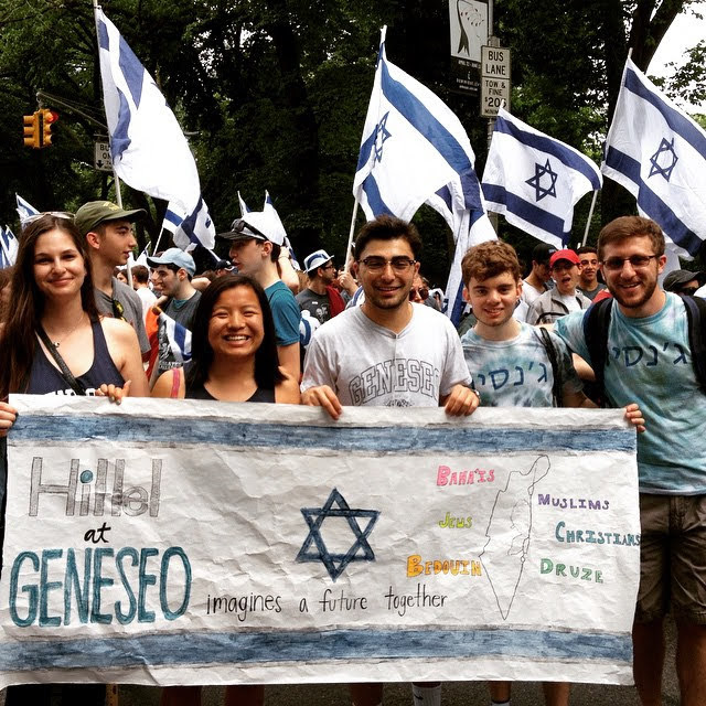Students with Hillel sign