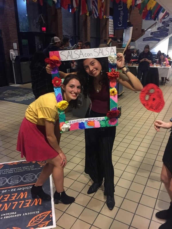 Salsa Con Salsa event, students posing with photobooth props