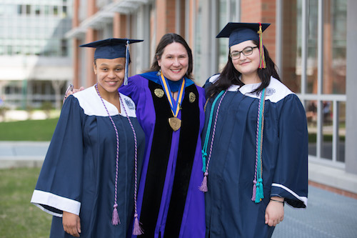Tanairi Taylor, left, and Terese Caiazza, far right, are the first to graduate as women's and gender studies majors. Professor of English and Music Melanie Blood is with them.