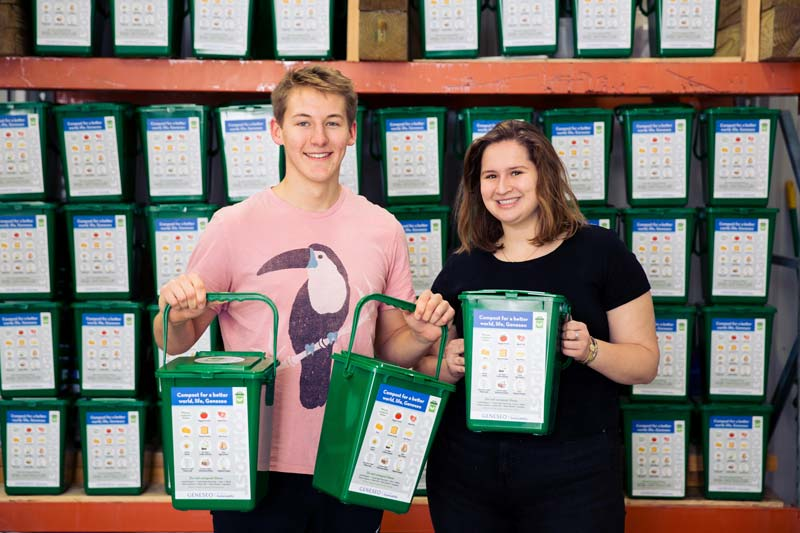 Alec Ritter '20 and Clara Gallagher '20 stand with the composting bins.