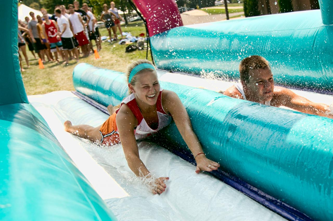 Sliding down a water slide