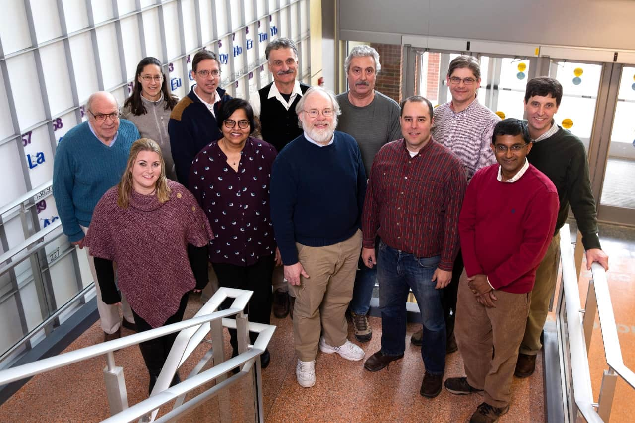 Members of the Physics and Astronomy Department at Geneseo pose for a photo in the ISC atrium.  Photo by Keith Walters.