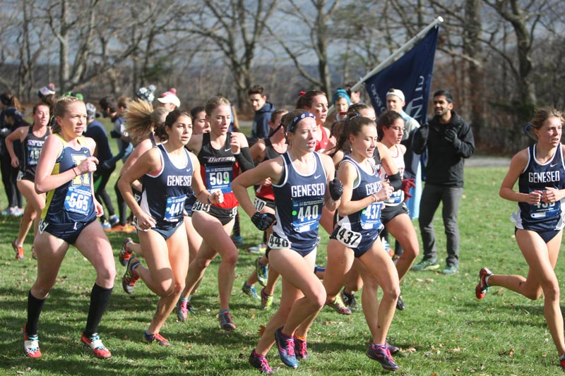 The SUNY Geneseo women's cross country team running in a group.