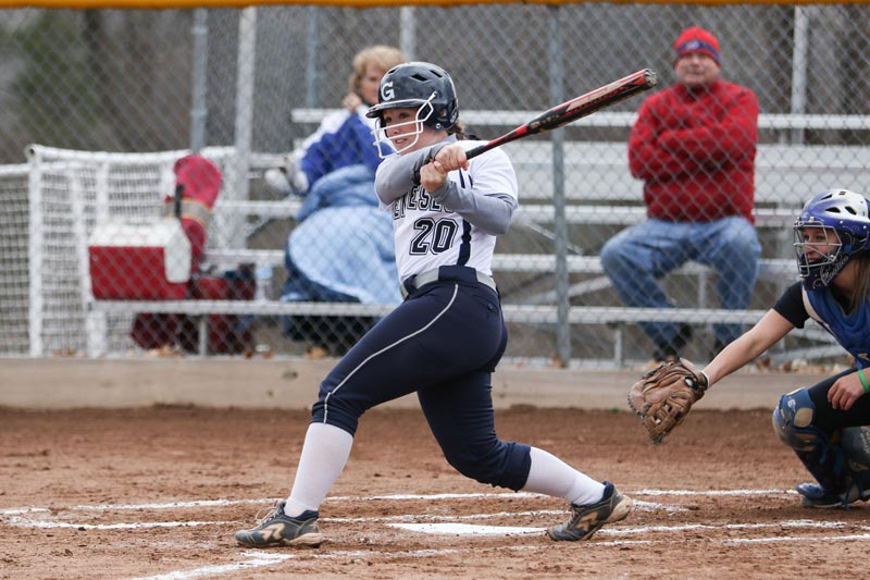 softball player mid swing