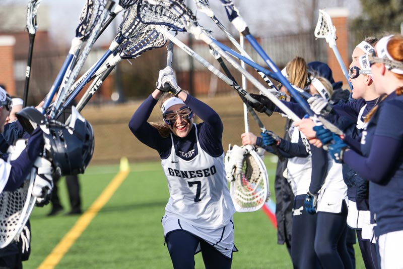 The SUNY Geneseo women's lacrosse team prepares for a game.