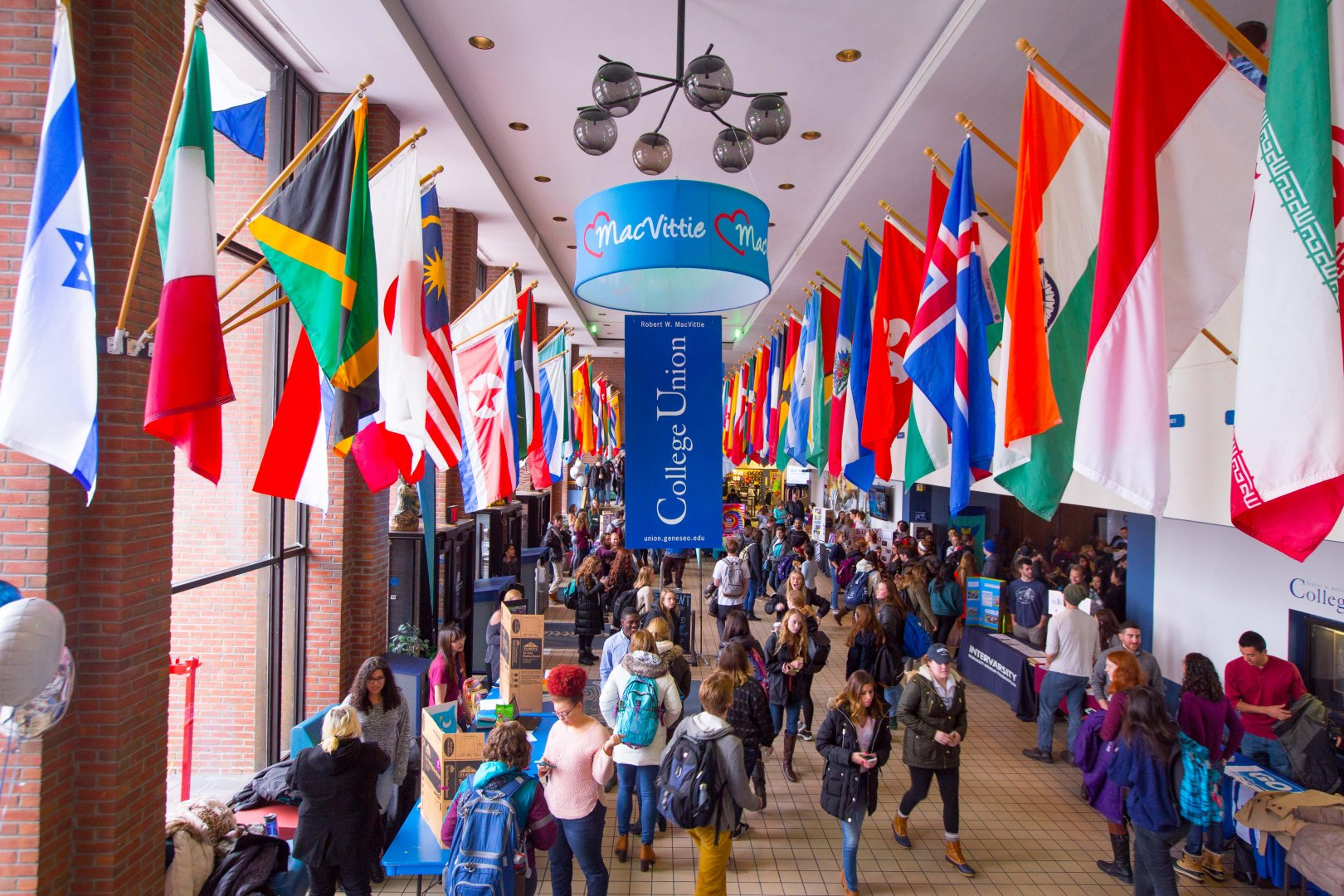 Students standing under multi cultural flags