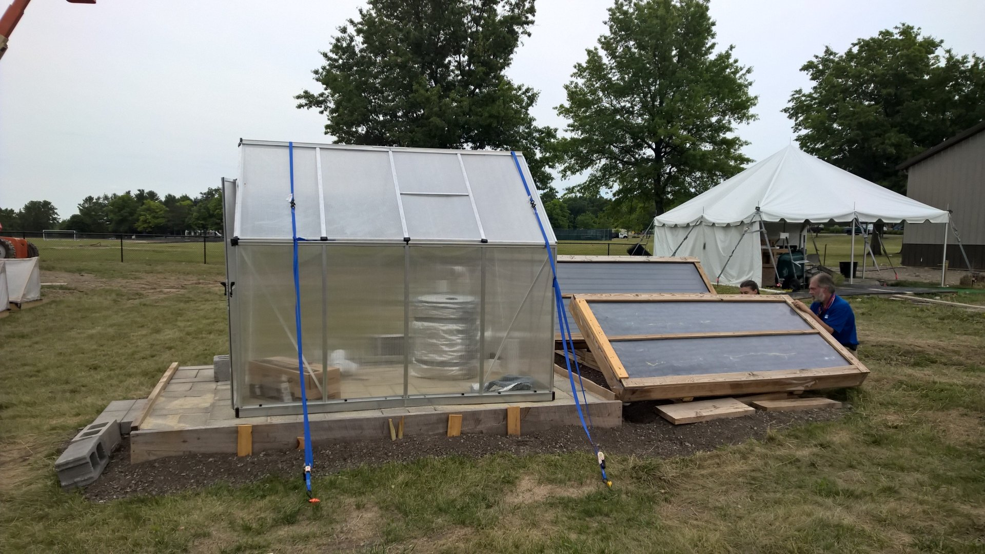 The greenhouse set up next to the collector.