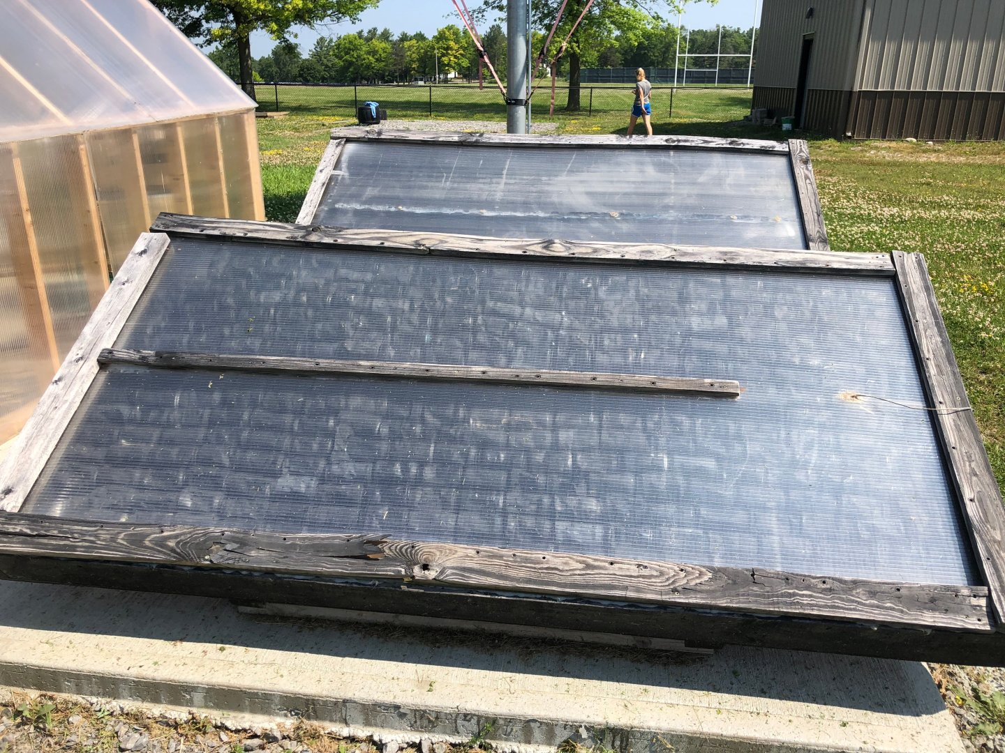Solar collectors next to the greenhouse