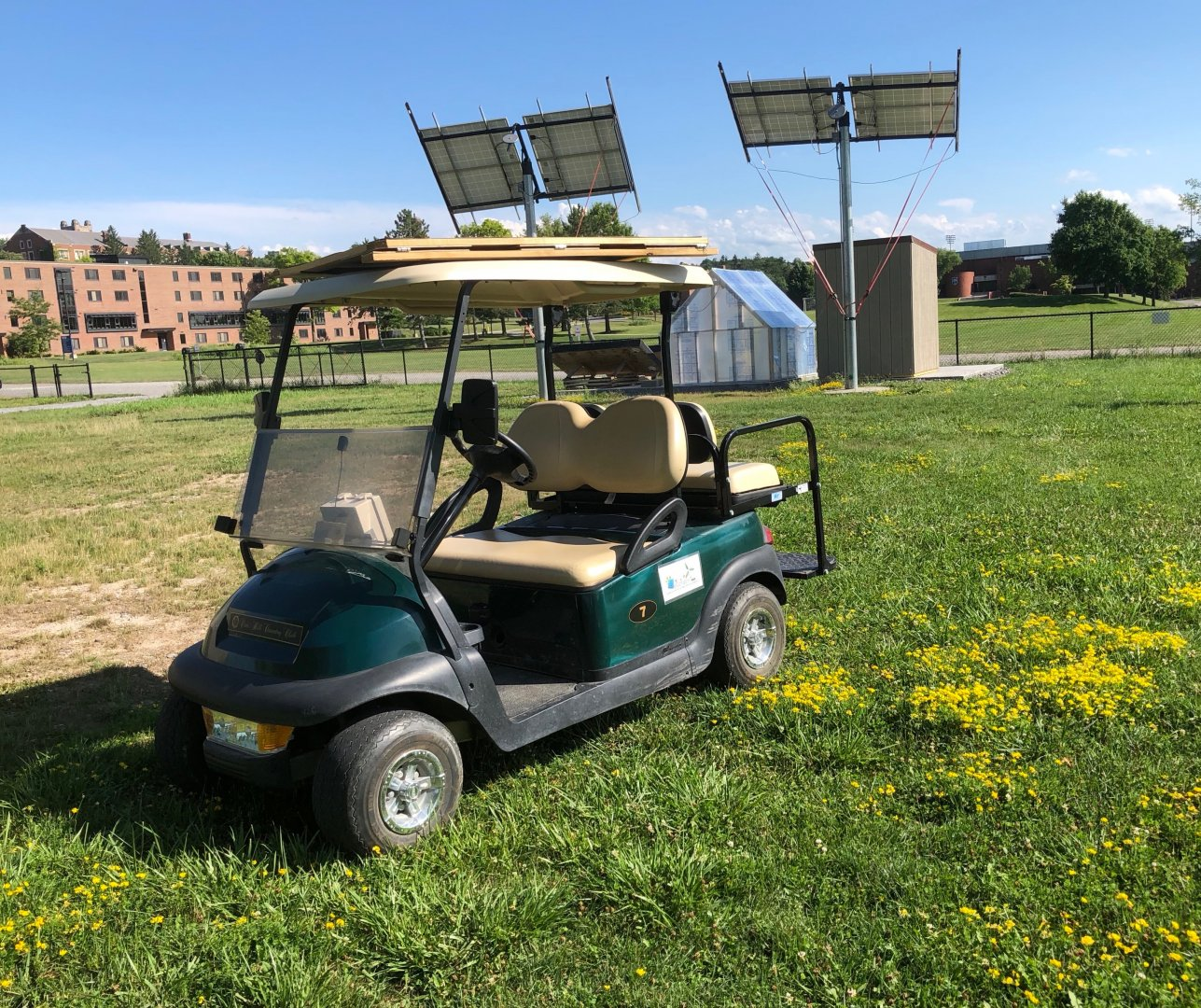 The eCart parked in front of the solar array in the eGarden.