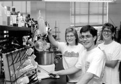 Students working in an lab, black and white.