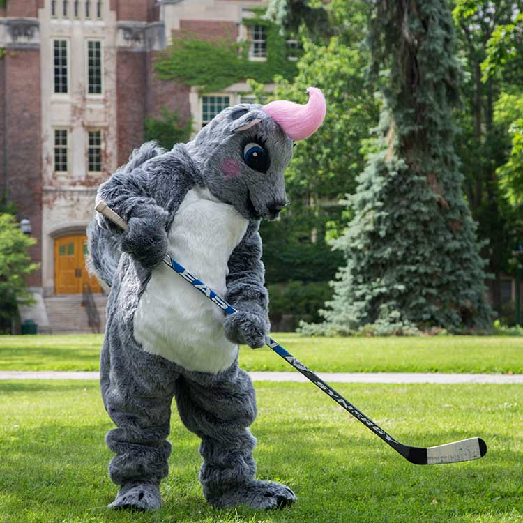 Genny the WGSU mascot with a hockey stick