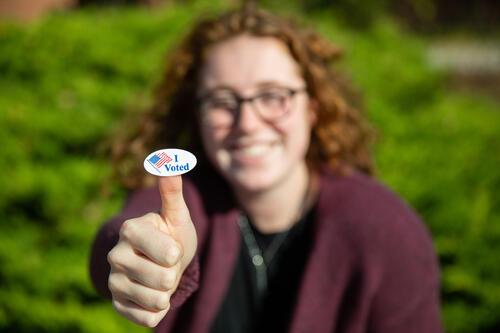 "Student with an ""I Voted"" sticker."