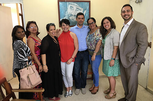 Sam Cardamone, associate director of the Study Abroad Office, at right, and Melanie Medeiros, assistant professor of anthropology, second to right, with representatives in Cuba.