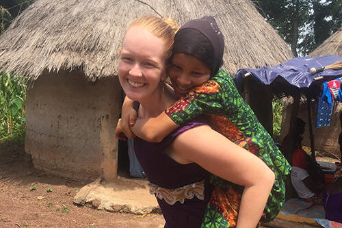 Jessica Kroenert '15 with a child from her village in Senegal.