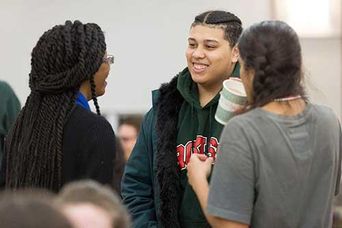 Students mingle during the Mardi Gras celebration.