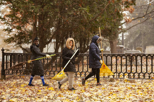 Student raking leaves