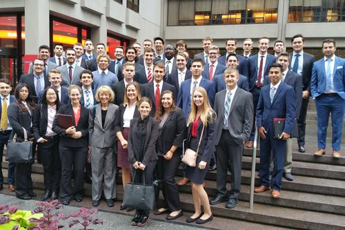 School of Business students and faculty on the steps of a firm in NY.