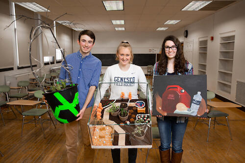 Ethan Smith '20, Ariana Walczyk '19 and Sara Feinland '19 show their art projects for the course.