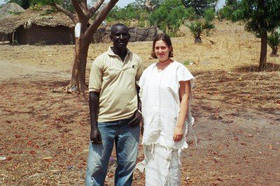 Wearing traditional fula dress with a young man.