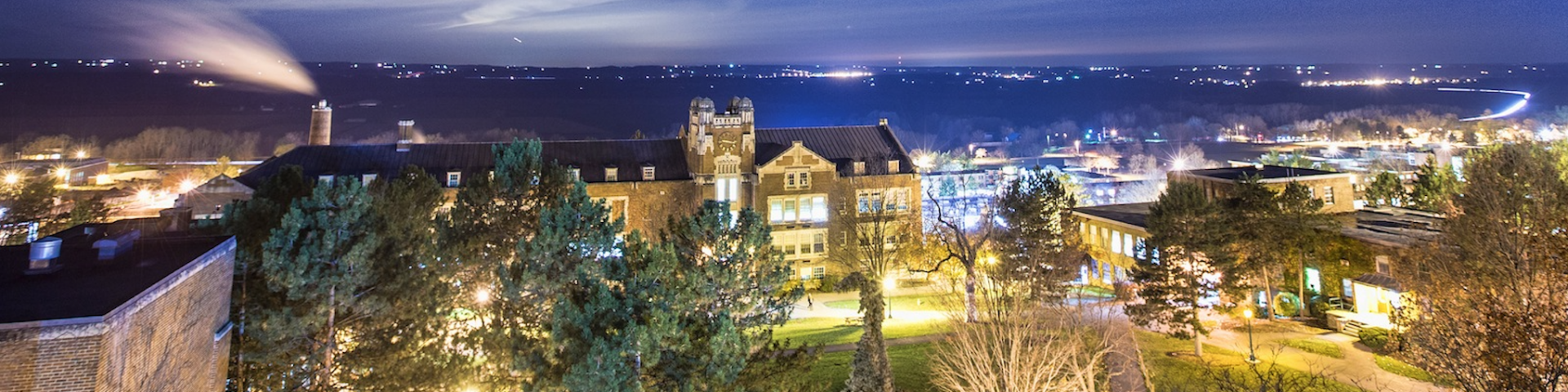 Up-high photo of Geneseo campus at night.